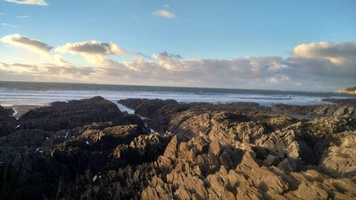 Surf in the distance on a rocky beach