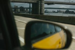 river bridge through car window on cloudy day