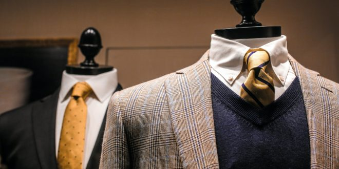 elegant male outfits on dummies in modern boutique