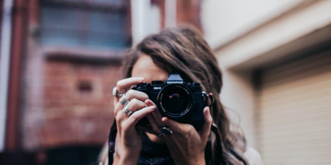 anonymous woman with photo camera