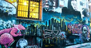 photography of graffiti on brickwall